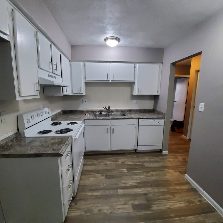 Open kitchen with full sized electric stove and dishwasher